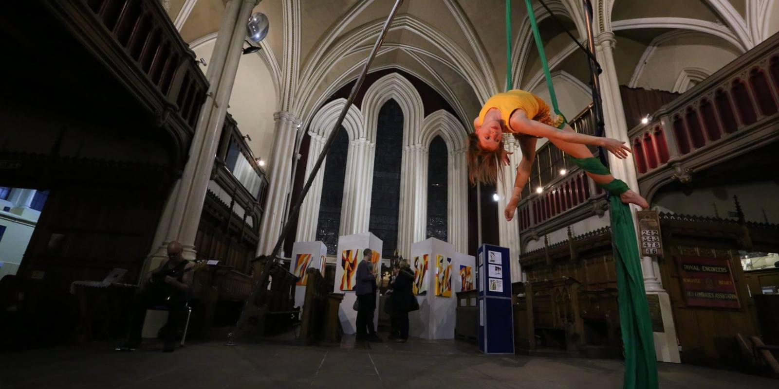 Aerial silks performance in church, with live music